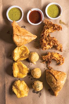 From SAVEUR Issue #167 These triangular deep-fried pastries stuffed with spiced potatoes and peas are an iconic Indian snack. Pair them with tangy tamarind chutney or herbaceous coconut-cilantro chutney for dipping.