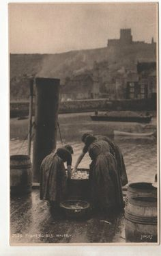 Fishergirls sorting through fish in barrels at Whitby. Whitby England, Yorkshire England, North Yorkshire, Yorkshire Towns, Oxford England, Cornwall England, Yorkshire Dales, London England, Antique Photos