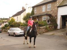 An iconic moment in South Zeal...a horse and rider going home.