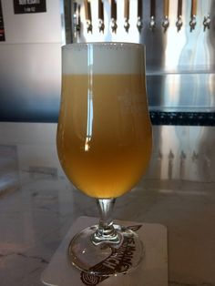 A Nitro Blonde at Peace Tree Brewing's brand new brewery and tap room in Des Moines. Its their signature Belgian strong ale but smoother on the palate. Bright, fruity, 8.5% ABV.