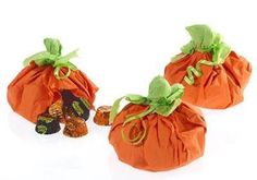 Fill these Pumpkin Favor Pouches with HERSHEY'S KISSES Chocolates for your party guests!