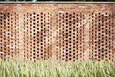 The brick walls are open to the elements—a technique borrowed from tropical climes to keep indoor spaces cool. The architects landed on the concept when they sought natural light without large windows, to avoid unwanted cost and maintenance. The open-brick solution helped meet the clients' total budget of €60,000 (about $65,000). Wirth-Architects-Brick-Garage-Gardenista-9