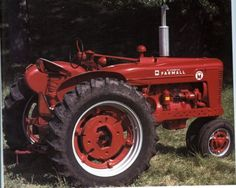 My dad has a tractor just like this one ~ Farmall Super M