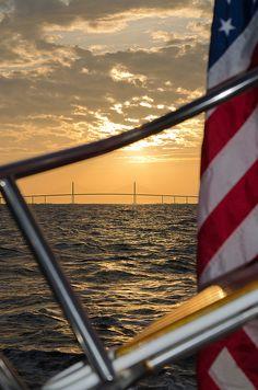 Sunset with USA Flag & Sunshine Skyway Bridge.