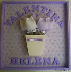 cuadro con tulipanes y nombre.