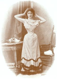 A woman models a corset in this 1898 photograph