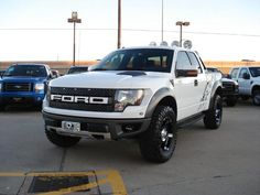a white ford raptor.. my dream truck!!! <3