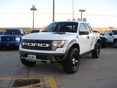 a white ford raptor.. my dream truck!!! <3