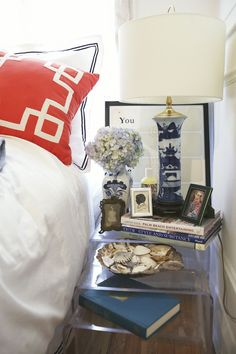 Colette Conway's Lincoln Park Apartment Tour // bedside table // lucite nesting tables // navy // orange // bedding // bedroom // #smallspace // Photography by Coach House Pictures
