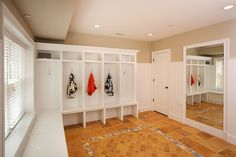 Large mud room with full length mirror for that last check before you walk out the door...