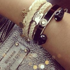 Today's arm party! A mix of silver, black and white.   #lepapillon #lepapillonbrand #lepapillonaccessories #h #coach #bangle #bracelet #katespade #fashion #fashionicon #fashionstudy #armswag #armcandy #armparty #instadaily #trend #skull #dogtag #braid #mcqueen #february2013