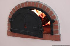 Wood Burning Pizza Oven Shoehorned Into a Kitchen Wall (Without Any Electrical Dependency, Such as Electric Starters)