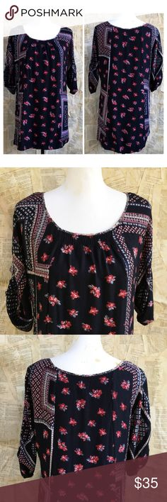 """Anthropologie boho black floral tunic Edme and Esyllte black and red floral tunic. Boho feel with smocking at neckline. 3/4 length sleeves. Inner tab on sleeve. Can be buttoned up or worn down. In gently used condition. No issues. 100% rayon. Underarm to underarm 18"""", length 29"""". Cute with skinny jeans, shorts, flares. Versatile piece. Anthropologie Tops Tunics"""