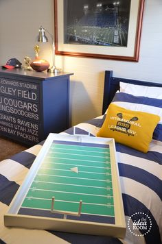 Boy's Room.  I pinned this for the dresser drawer design. Very unique. Maybe I could make an ice hockey rink instead of the football field.
