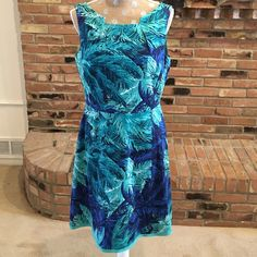 """Multi-blue print fit and flare dress NWOT. Measures 38"""" from shoulder to bottom of hemline. 19"""" from armpit across. 97% cotton, 3% spandex. Lining 97% polyester, 3% spandex. Made in China. Dresses Midi"""