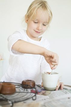 Kids baking chocolate donuts :) An Easter shoot by Confetti Mag - www.confettimag.c... Photo by Honey Atkinson, Styling by Karen Locke.
