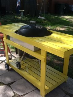 Table built around a weber grill
