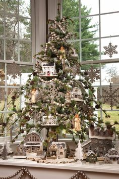 Charming Christmas tree decorated with Christmas Putz houses and with silver glitter snowflakes & stars, etc. Country Christmas Trees, Tabletop Christmas Tree, Beautiful Christmas Trees, Christmas Villages, Christmas Love, Xmas Tree, Winter Christmas, Christmas Tree Decorations, Christmas Houses