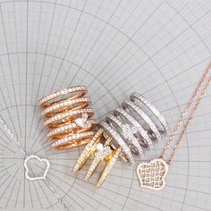 Sarah Ho Jewellery   New Stack Rings and Monogram Pendants Mix and Match Gold Clash - Sarah Ho Signature Monogram Collection These stack rings are each individually hinged together along the back spine #Gold #Diamonds #style #fashion #jewellery