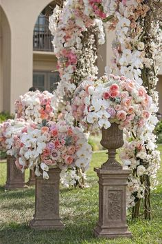Beautiful wedding ceremony arrangements and floral arch