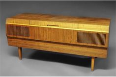 A HMV radiogram, circa 1970, with Garrard deck, in teak cabinet, with top lid, raised on square t
