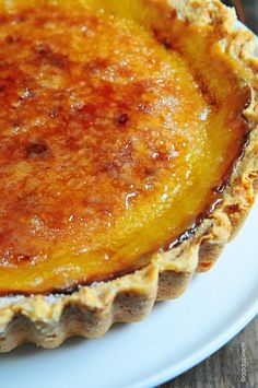 Bruleed Lemon Tart | This is sure to bring smiles at the table! Just look at that crunchy bruleed top!  addapinch.com