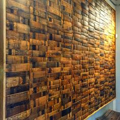 Wine or whiskey barrel stave wall paneling can make a bold statement.