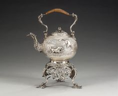 A George III silver kettle on stand, by Edward Farrell, London 1818, of globular form and chased in high relief with a fox and hound on one side and a gun dog with game bird opposite, within a wooded scene and stippled ground, hinged domed cover with seed pod finial on leaf scroll calyx, the raffia-bound swing-handle with leaf junctions and flowers, cast leaf-capped spout with leaf scroll lower section and bearded mask to front, on an openwork stand with a band of flowers among leaf scrolls