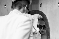 BIGBANG in America: Exclusive Backstage Photos --- BIGBANG member G-Dragon checks his reflection before hitting the stage at his group's sold out performance in Newark's Prudential Center (Nov. 9).