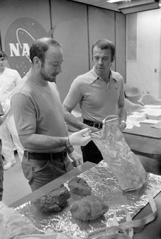 (19 Feb. 1971) — The two moon-exploring crewmen of the Apollo 14 lunar landing mission show off some of the largest of the lunar rocks they collected on their mission, during a through-the-glass meeting with newsmen in the Crew Reception Area of the...