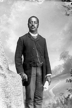 African American man in striped tie and pants, holding new…   Flickr