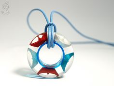 Ship ahoy - maritime boat pendant with hand-made folded mini boats made of blue, red and white paper on a blue ring made of resin ///// © Isabell Kiefhaber www.geschmeideunterteck.de