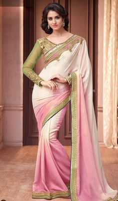 Look more than enchanting and adorable wrapped on this pink and cream color shimmer georgette sari. Beautified with lace, resham, sequins and stones work. #latestdesignsaree gorgeousembroideredsari #pinkshadessaris