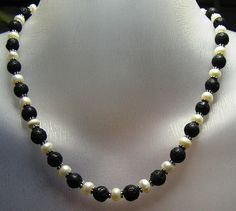 Lava Rocks Pearls - stunning necklace which combines rough lava beads with cultured pearls. $49.00