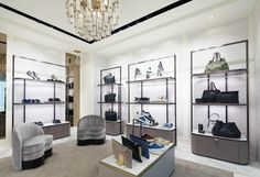Jimmy Choo's dual gender store in Xian, China introduces its open floor plan with a grand, four sided façade providing transparency into the store. Shop Interior Design, Interior Decorating, Visual Merchandising, Fashion Store Design, Shelving Design, Retail Store Design, Design Furniture, Stores, Jimmy Choo