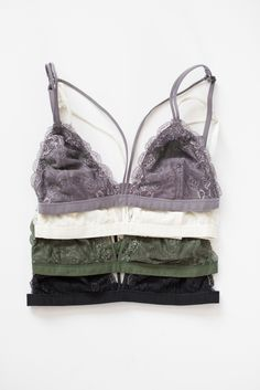 - Delicate strappy lace bralette - Scalloped edges - Hook closure in back…