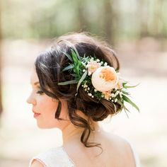 Beautiful flower detail in this Wedding Updo