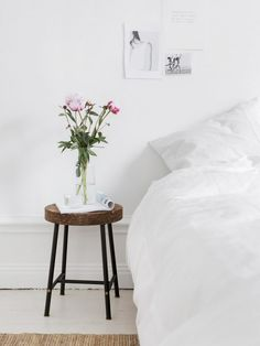 Minimalist bedroom with an IKEA stool doubling as a nightstand