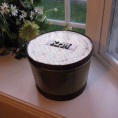 Popcorn tin repurposed as a gift box