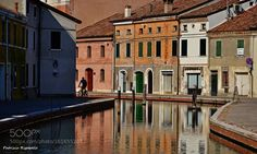 Cyclist in Comacchio by patrizrigobello