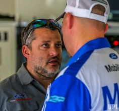 Stewart-Hass Racing Co-Owner Tony Stewart talks with Crew Chief Mike Bugarewicz of Clint Boyer's team before practice on February 24, 2017…