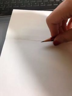 Hold the pencil still, then rotate the paper. This technique is very useful when you forgot to bring your compasses in an exam. :)