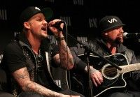 """Recording artists Joel Madden (L) and Benjamin (Benji) Madden of Good Charlotte perform on stage at BMI's """"How I Wrote That Song"""" at Key Club on February 11, 2012 in West Hollywood, California."""