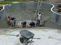 Troweling the dry gunite to make our solid pool base. We then foam the concrete flats and drop the vinyl liner on top of it all.