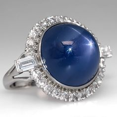 Star Sapphire Cocktail Ring With Diamond Halo, White Gold - Star sapphire cocktail ring features a centered round cabochon-cut non-enhanced natural blue star sapphire bezel set into a halo of round brilliant cut diamond accents. Star Sapphire Ring, Sapphire Jewelry, Blue Sapphire Rings, Halo Diamond, Diamond Stud, Edwardian Jewelry, Vintage Jewelry, Handmade Jewelry, White Gold Jewelry