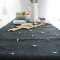 Simple stitched table runner tutorial for a nod to Scandinavian style.