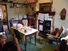 1940's living room - I like this one as it is very much like our living area in the 1940's - our kitchen range was a bit different, the fire part had bars in front of it, and we had an old dresser, plus a velvet pelmet hanging around the mantelpiece (and although we had a gas stove we could also boil a kettle on the kitchen range)