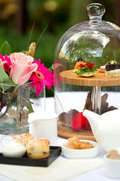 A beautiful complement to the Afternoon Tea tabletop is the matching of fresh florals. At The Ritz-Carlton, Dove Mountain, vibrantly-colored macarons are a perfect complement to similarly-hued flowers placed close to the tea setting.