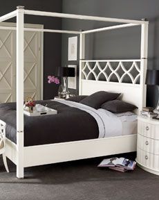 Not normally a fan of the canopy style bed but this one I just love...and there's that wall color again.  Like dark steel gray.  I must use that color in my house.
