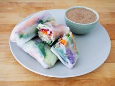 Pickled melon spring rolls with almond ginger dipping sauce